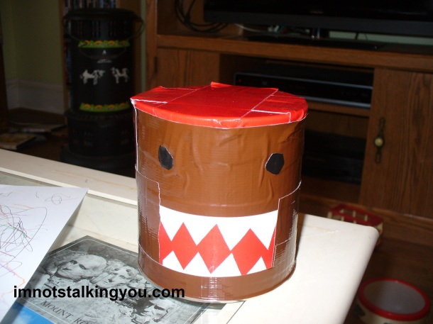 Domo drum, made from duct tape and a toddler snack can