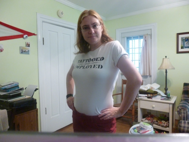 A new shirt I am proud of, with my non-jean pants, sucking in my stomach, wearing a leftover goth bracelet on a very humid day where my hair might do something--or not.
