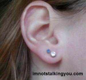 New earring is the fake diamond bling one.