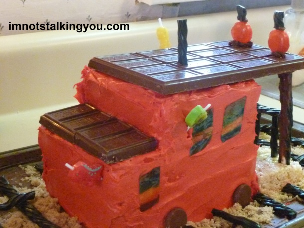 Caboose with dinosaur candles inserted