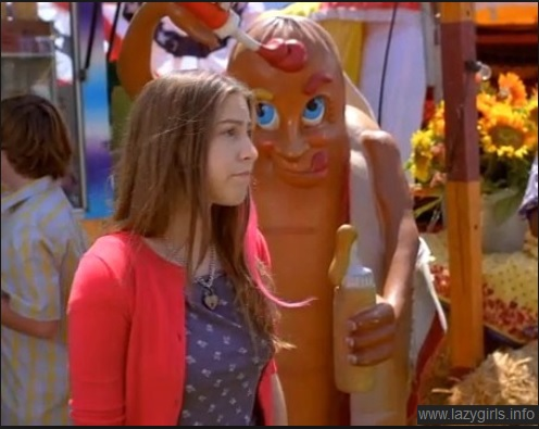Sue Heck from The Middle standing in front of a giant hot dog.  It is like this picture was MADE for this post!