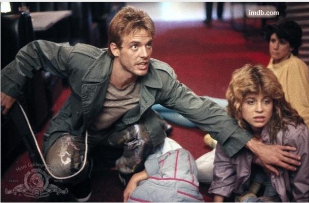Reese saving Sarah Connor in Terminator