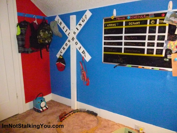 Railroad crossing sign coat rack. Really pulls the room together.