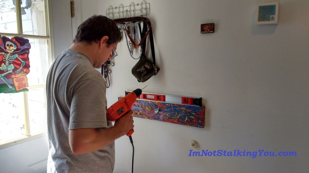 Manly husband with power tools doing installation. Ahr, ahr, ahr. Now, where did we leave those studs???