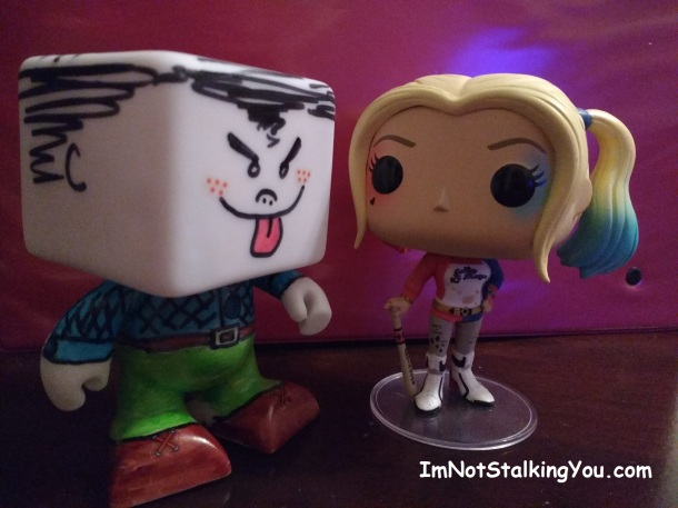 Mr. Ugly-Man puts the moves on Harley Quinn. But she ain't havin' it. Watch out for that bat.